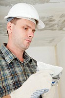 Contractor pargets the ceiling