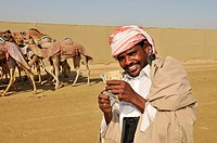 Camel driver with stakes, Al Sheehaniya, camel racing track, Doha, Qatar, United Arab Emirates, Middle East