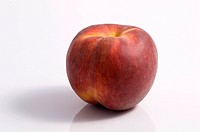 One peach fruit on white background