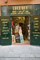 Stacks of books in front of bookstore in centro district of Sevilla, Spain