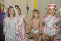A preschool class playing dressup