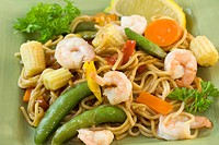 shrimp with stir fry noodles, baby corn, and green snap peas
