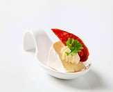 Cheese hors d´oeuvre on a porcelain spoon