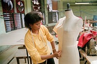 Woman designing clothes in factory in Havana, Cuba,
