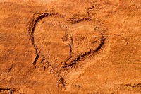 Shape of an heart scraped into the red sandstone