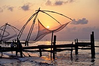 Chinese fishing nets, coast of the Arabian Sea at sunset, Fort Kochi, Cochin, Kerala, South India, India, Asia