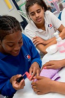 Beauty therapy student learning how to paint nails,