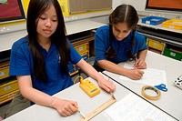 Two secondary school girls measuring resistance in Physics lesson