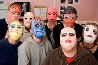 Group of students wearing masks they have made, Sycamore Centre Nottingham,