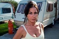 Woman standing outside her caravan,