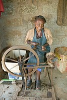 Masai woman weaves rug as part of a community based business at the Lewa Foundation in North Kenya, Africa. Community conservation programs have been ...