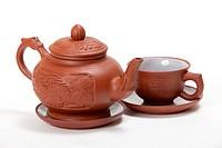 Teapot and mug on a white background. isolated image