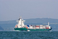 Container ship sailing to the port