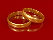 Gold rings on a red background