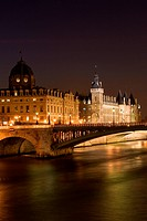Night view of the Conciergerie old medieval jailhouse and the Seine river _ Paris, France