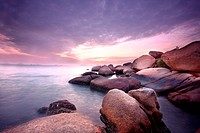 Sea stones at sunset in hong kong.
