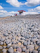 A lifeguard lookout hut on the top of the pebble ridge at Westward Ho!, Devon, England, United Kingdom