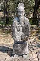 A stone statue of a man at the tomb of Emperor Tu Duc, near Hue, Vietnam