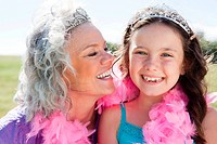 Grandmother and granddaughter wearing pink feather boas
