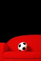 Soccer Ball On Red Couch