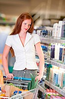 Red hair woman in cosmetics department of supermarket