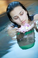 Teenage Girl in Water with Petals