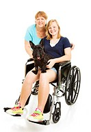 Disabled teen girl in wheelchair, posing with her mom and dog. Full body isolated.