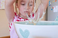 Girl whisking in kitchen