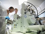 Scientists working with equipment in lab