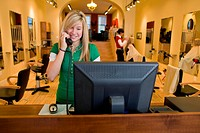 Receptionist Answering Phone in Hair Salon