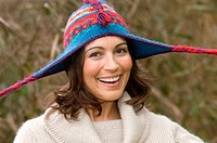 Smiling woman wearing knitted hat