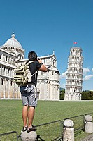 Man taking digital picture of the Leaning Tower of Pisa and Cathedral