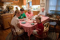 A family sits down together for dinner in Elkhorn, NE.