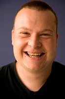 Portrait of day service user with learning disabilities laughing