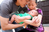 Chinese parents with baby