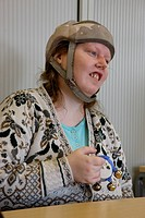 Drumming class for people with learning disabilities _ woman with epilepsy wearing helmet