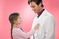 Girl examining doctor
