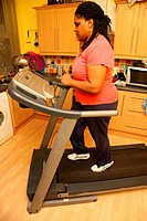 Portrait of black woman on a treadmill