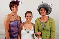 Bride who has cerebral palsy, with mother and sister at wedding ceremony