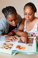 Mother and daughter looking at cookery book Cleared for Mental Health issues