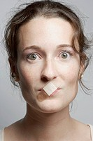 Woman with bandage on mouth