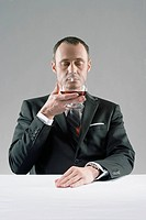 Man sniffing glass of cognac