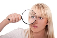 pretty blond young woman with magnifying glass