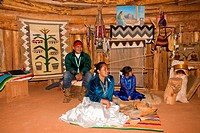 United States, Utah, Monument valley tribal park, Navajo reserve, navajo indian in traditional clothes inside a hogan.
