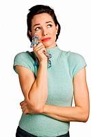Beautiful woman wiping tears with handkerchief