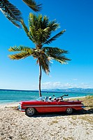 Ancon beach, Classic car and music band , Trinidad city, Sancti Spiritus Province, Cuba.