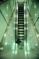 Man on escalator
