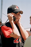 Boy Baseball Player Talking on a Cellular Phone