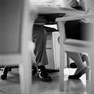 Businesspeople´s Legs Under Desk