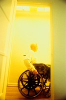 Man in Wheelchair Passing Doorway
